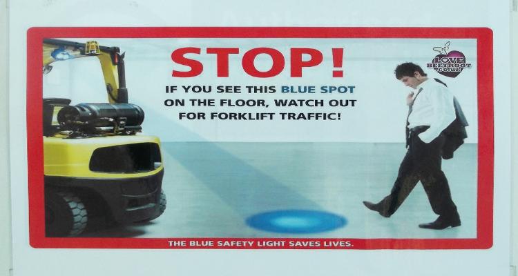 Blue spot warning system for forklift trucks